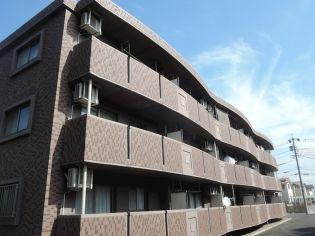 愛知県北名古屋市九之坪庚申前の賃貸マンションの外観
